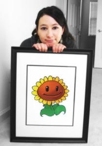 Laura Shigihara poses with a sunflower character from Plants vs. Zombies